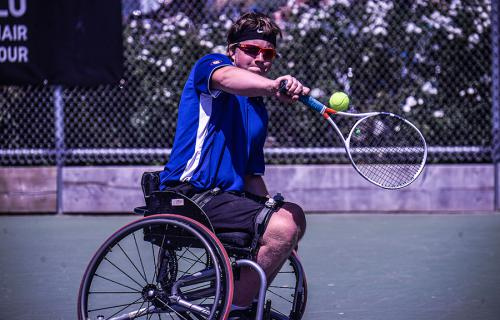 Wheelchair Tennis player Thomas Venos prepares to return a ball.